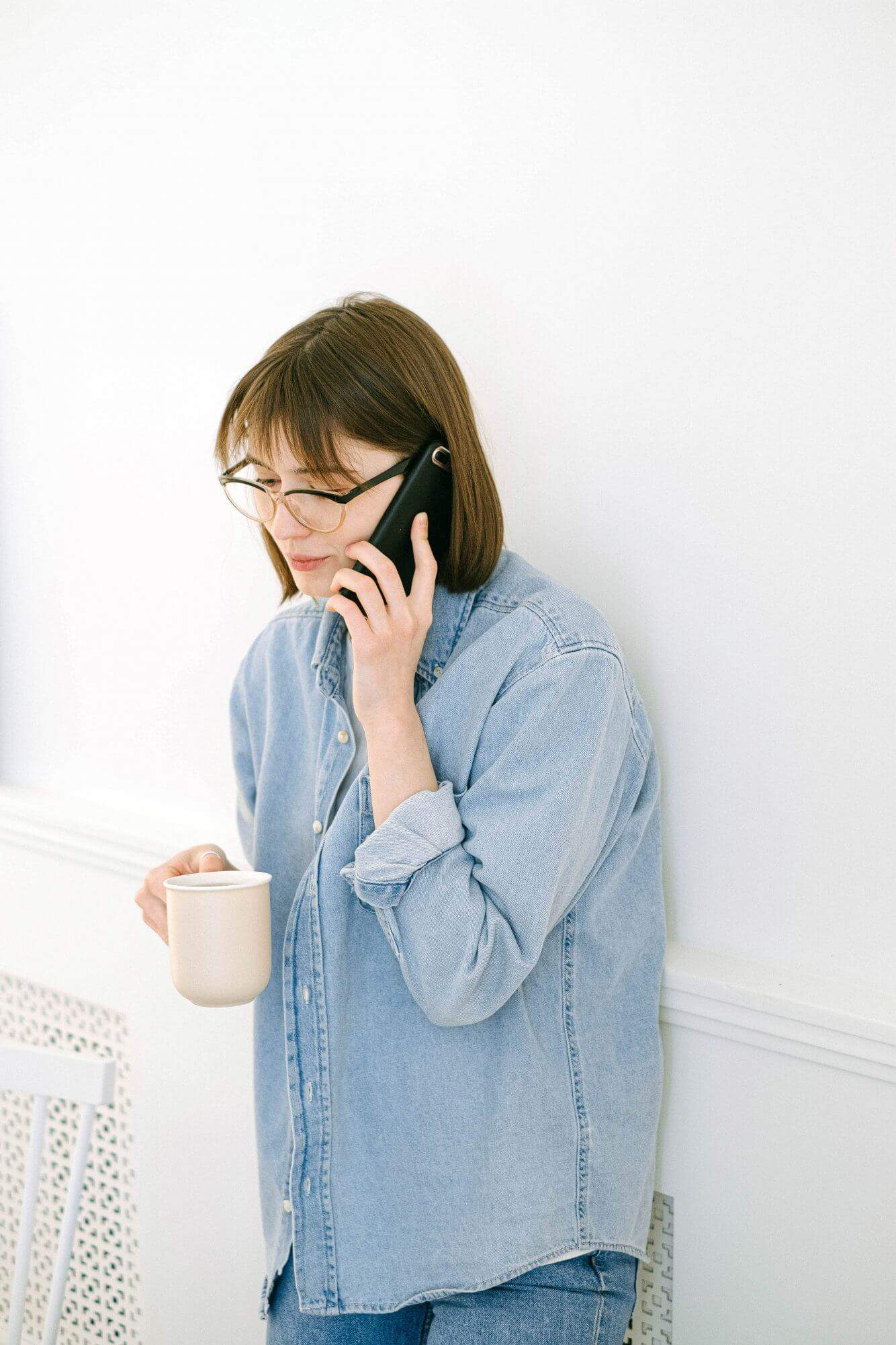 woman on the phone talking to an insurance advisor